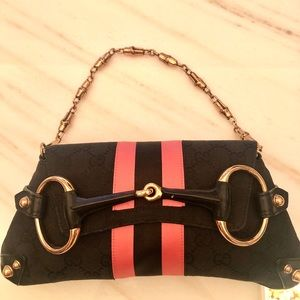 Vintage Gucci clutch with strap